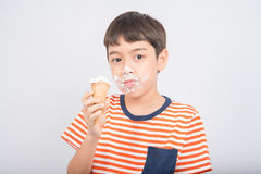 Little boy eating chocolate icecream with happy face summer time Royalty Free Stock Photography