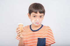 Little boy eating chocolate icecream with happy face summer time Royalty Free Stock Photo
