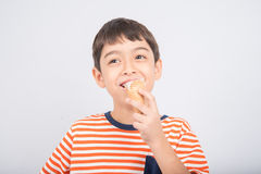 Little boy eating chocolate icecream with happy face summer time Stock Images
