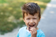 Little boy eating chocolate Royalty Free Stock Image