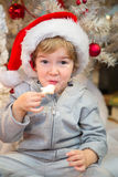 Little boy eating Christmas cookies. Royalty Free Stock Images