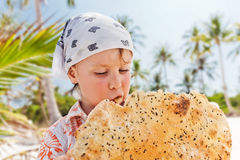 Little boy eating a cookie Stock Photography