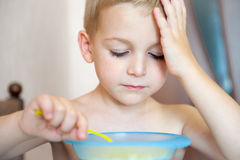 Little boy eating corn flakes with milk Royalty Free Stock Photography