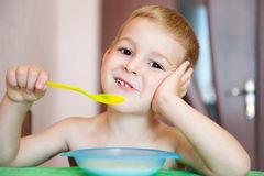 Little boy eating corn flakes with milk Royalty Free Stock Photos
