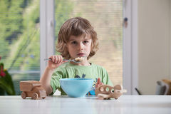 Little boy eating royalty free stock images