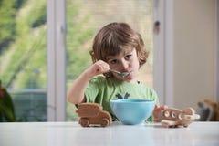 Little boy eating stock image