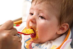 Little boy eating food Stock Photo
