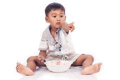 Little boy eating food royalty free stock image
