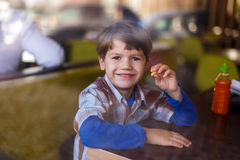Little boy eating french fries Royalty Free Stock Photo