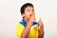 Little boy eating fried chicken Royalty Free Stock Photography