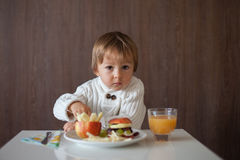 Little boy, eating fruit sanwich Stock Photography