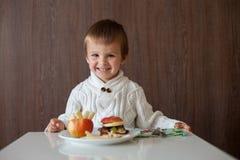 Little boy, eating fruit sanwich Stock Photos