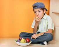 Little boy eating fruits Stock Image