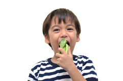 Little boy eating green vegetable for health Stock Photo