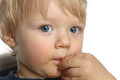 Little boy eating by hands Stock Photography