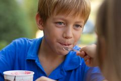 Little boy eating ice-cream Royalty Free Stock Photography