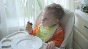 The little boy is eating ice cream stock video footage