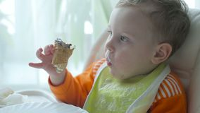 The little boy is eating ice cream stock video