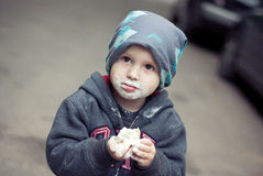 Little boy eating ice-cream Stock Photos