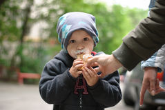 Little boy eating ice-cream. Outdoor shoot Stock Images