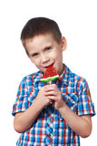 Little boy eating a lollipop watermelon. Isolated Royalty Free Stock Photos