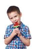 Little boy eating a lollipop watermelon Royalty Free Stock Photos