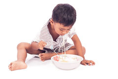 Little boy eating noodle Royalty Free Stock Image