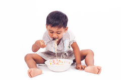 Little boy eating noodle Stock Images