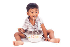 Little boy eating noodle Stock Photos