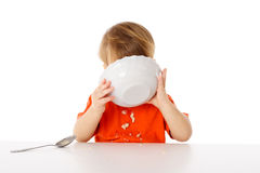 Little boy eating the oatmeal Royalty Free Stock Images