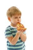 Little Boy Eating Pizza Royalty Free Stock Image