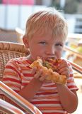 Little boy eating a pizza Royalty Free Stock Photos