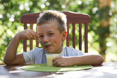Little boy eating pudding Stock Photo
