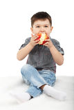 Little boy eating a red apple Royalty Free Stock Photography