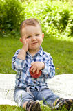 Little boy eating red apple Royalty Free Stock Images