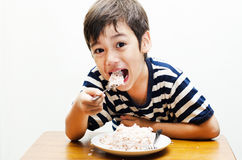 Little boy eating rice happy face Stock Photo