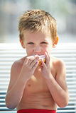 Little boy eating a sandwich Royalty Free Stock Photo