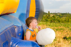Little boy eating a serving of candy floss Royalty Free Stock Photography