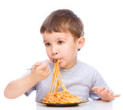 Little boy is eating spaghetti Stock Photography