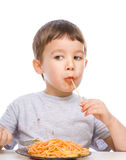 Little boy is eating spaghetti Royalty Free Stock Image