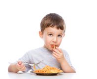 Little boy is eating spaghetti Royalty Free Stock Images
