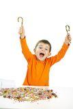 Little boy eating sweets Royalty Free Stock Images