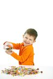 Little boy eating sweets. Happy child ( four years old little boy ) eating sweets, isolated on white background royalty free stock image