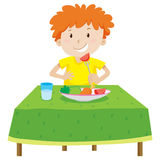 Little boy eating on the table Royalty Free Stock Photo