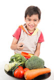 Little boy eating vegetable Royalty Free Stock Images