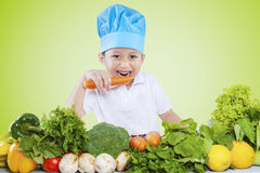 Little boy eating vegetables Royalty Free Stock Photography
