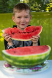 Little boy eating watermelon in the garden. Royalty Free Stock Photo