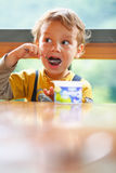 Little Boy Is Eating Yogurt. Stock Photo