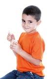 Little boy eating yogurt Stock Photo