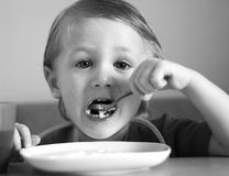 A little boy eats. Stock Photography